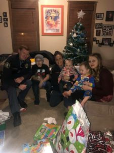 BBO members in St .Paul area deliver donated Christmas gifts to children of a family that lost their father suddenly